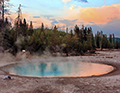 West Thumb Geyser Basin thermal pool at sunset