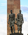 Soldiers in front of the Monument to the Heroic Defenders of Leningrad